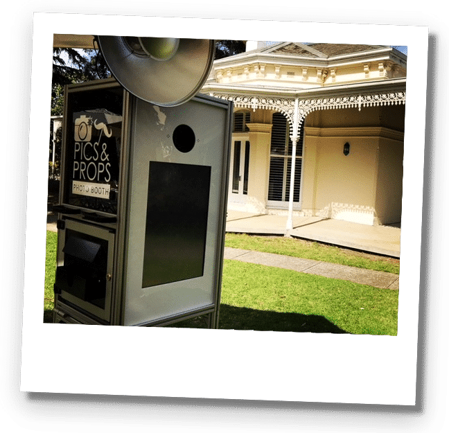 Photo booth situated outside on a grassy lawn